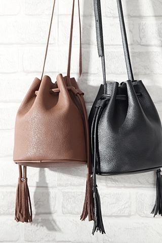 Faux Leather Bucket Bag Showcasing Tassel Detailing in Brown or Black